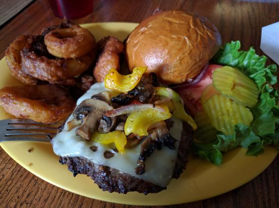 South Park Saloon: Juicy burger with onion rings on the side.