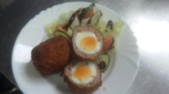 Leeming Bar, UK: Homemade scotch eggs with salad and chips very tasty. Good value at just 4.99.