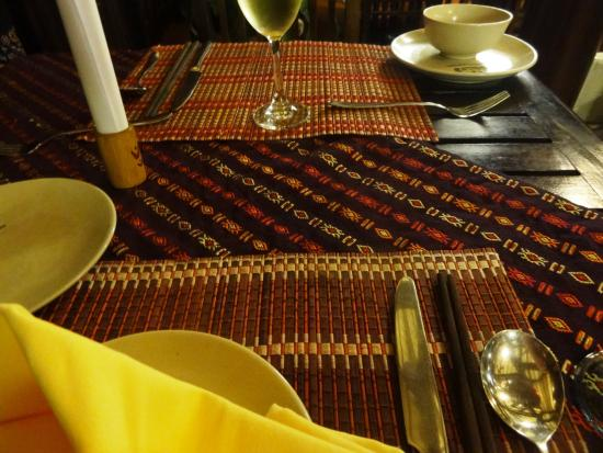 Mai Chau Lodge: The dining tables with beautiful handcrafted table cloth/mats