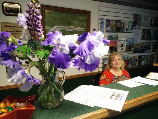 Onekama, MI: Beth and the flower from her garden.
