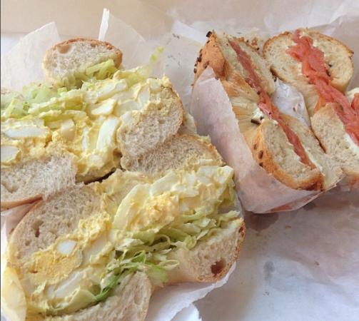 Tal Bagel: Onion bagel with egg salad and smoked salmon onion bagel.
