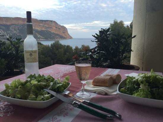 L'escale: Our take-out dinner, B&B balcony