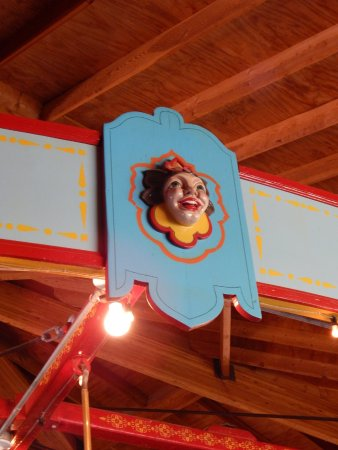 Story City, IA: Hand carved wooden faces on the top of the carousel.