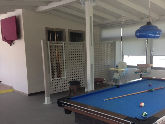 Nicon: Pool table (free) with ladies and gent toilets behind screen