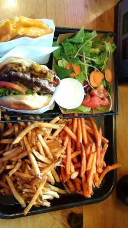 doible bacon cheesebirger, grilled cheese, side salad, sweet potato fries, regular fries.