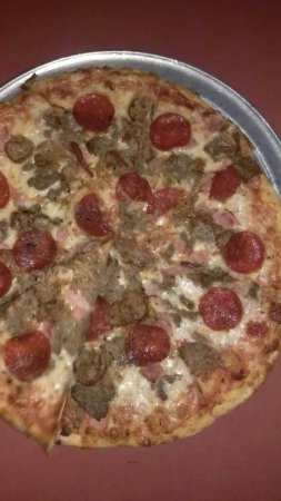May 2016 meat lovers pizza. Not like the one posted in the other pic in 2014, that's what they u