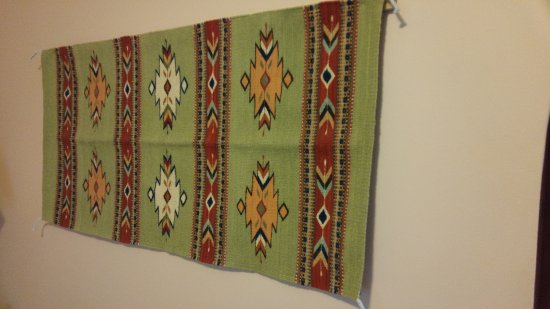 La Posada Hotel Navajo Rug Wall Hanging In Room