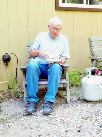 Woodland Resort on Lake Miltona: Greek enjoying what would be his last fish fry at Woodland