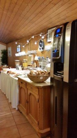 Tautermann: Breakfast spread and a modern coffee machine
