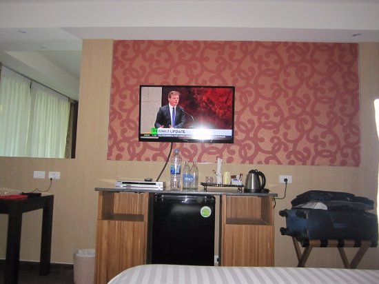 Dynasty Grande Hotel: Watching TV on the bed with DVD fridge free water kettle etc