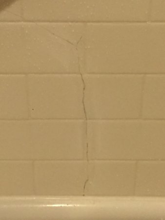 Sheraton Atlanta Perimeter North: Issues with room. Holes in wall, stained towels, cracks in tiles and missing tiles