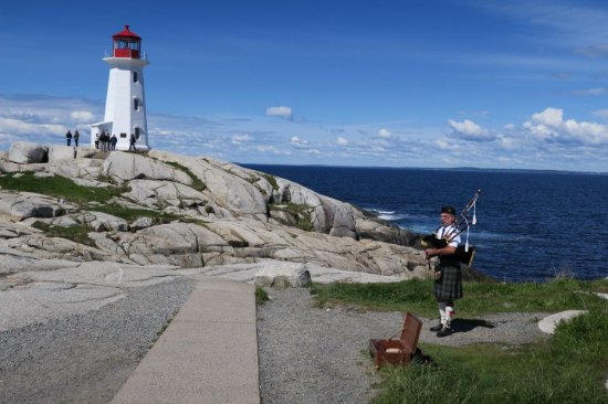Eastwind Cycle: Peggy's Cove with a bagpipe player