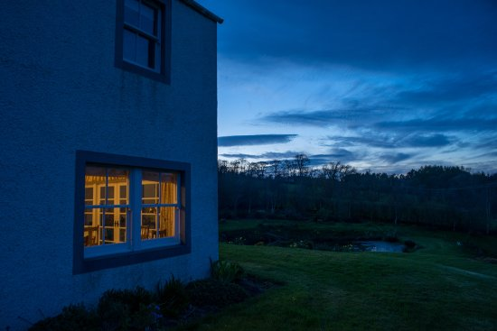 Bonchester Bridge, UK: HDR photo with view of the pond and dining room window.