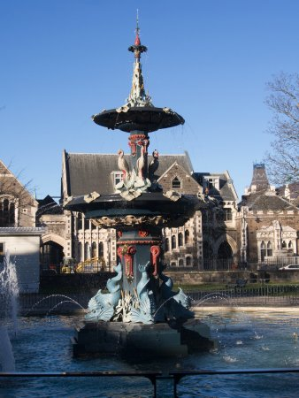 Peacock Fountain, Christchurch Botanic Gardens, with old university buildings under restoration.