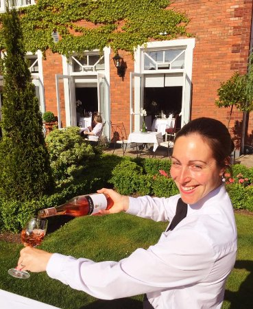 Hayfield Manor Hotel : Sandra our Head Sommelier is busy busy in our garden serving the finest Rose wine