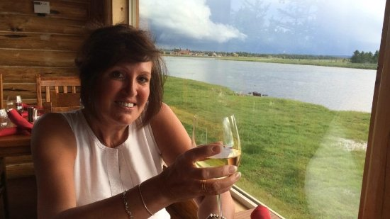 Island Park, ID: Barb enjoying dinner and wine