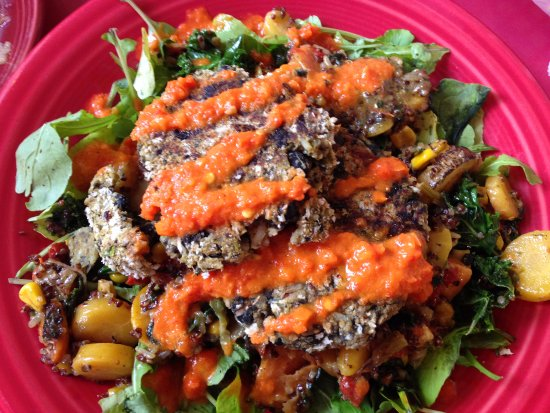 Fairview, NC: Black Bean Cakes with root vegetable hash, quinoa pilaf, baby arugula, and pepper coulis. Vegeta