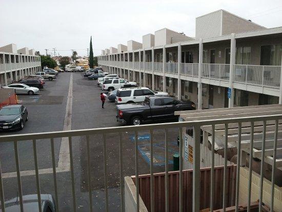 Studio 6 Cypress: parking lot looking west