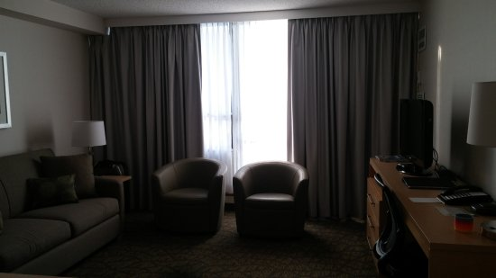 One bedroom suite, spacious sitting area, pull-out sofa, balcony, flat screen tv, phone, work de