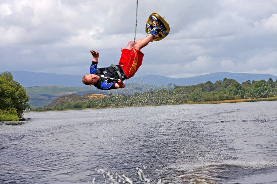 Parton, UK: Adam back rolling with the Galloway Hills in the back round at Loch Ken Water Ski and Wakeboard
