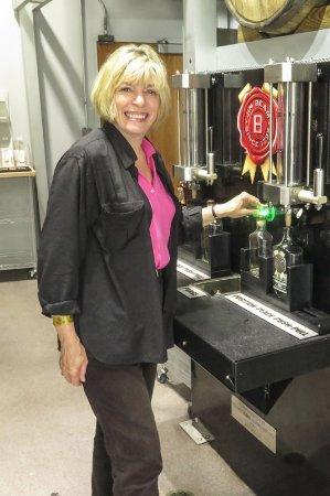 Jim Beam Urban Stillhouse: Filling her bottle.