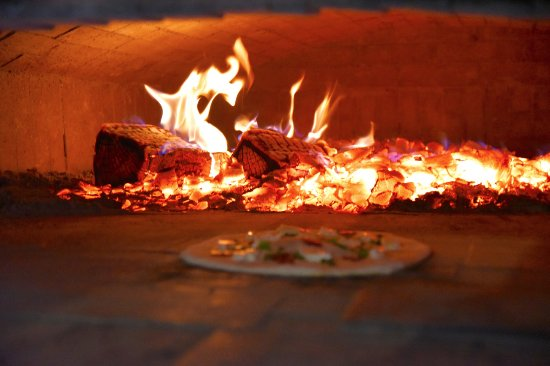 Ava, IL: My pizza cooking in the Scratch wood fired oven
