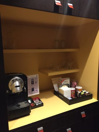 Eastwest Hotel: Coffeemaker and snacks, even a book!