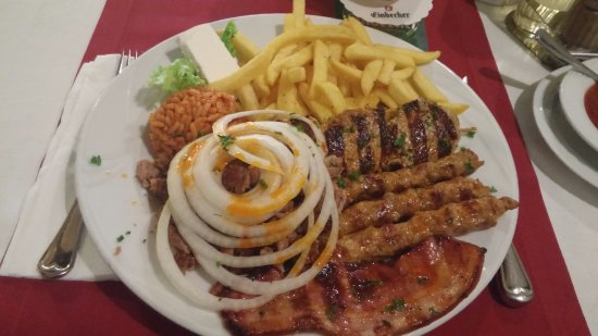 Balkan House: Combo plate: giri, minced pork, skewered pork filet, bacon, rice, fries, cheese
