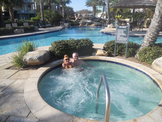 Villages of Crystal Beach: Lush grounds around pool and hot tub