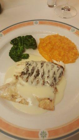 Zollikon, Sveits: Fisch mit Risotto