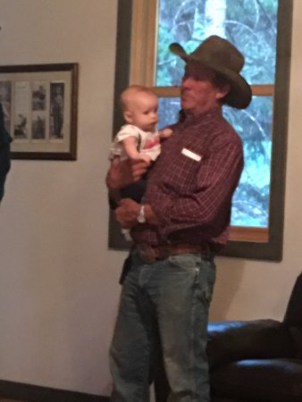 Grant, CO: Dave, Ranch Foreman, holding a baby so the parents could enjoy their dinner!