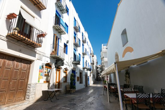 Pension Chiki on the left with balconies, hotel restaurant on the street