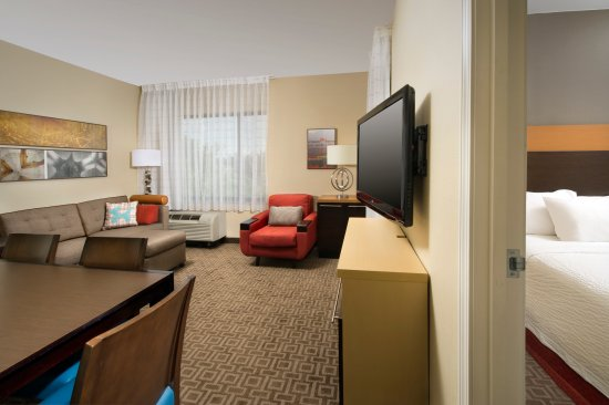 TownePlace Suites Lexington Park Patuxent River Naval Air Station : The Two Bedroom Suite's Living Area Features a Sofa Bed, Work Desk and HDTV with Premium Channel