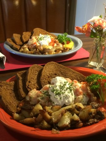 Arundel, ME: Mexican Poached Eggs On Homemade Corned Beef Hash. Two perfectly poached eggs on the best home m