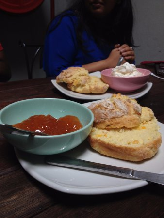Curepipe: Warm scones served with additional whipped cream and jam
