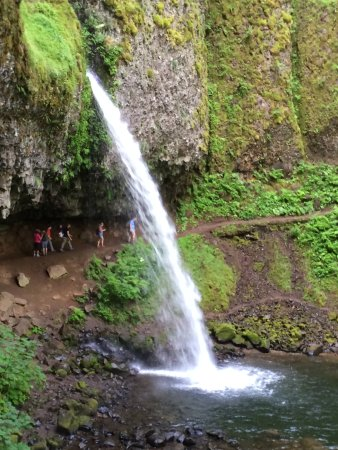 Hood River, OR: People walking behind Ponytail Falls