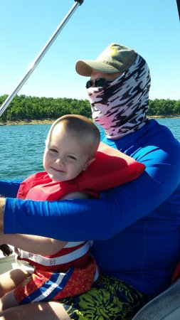 Waterfront Resort : Helping PawPaw drive the boat.