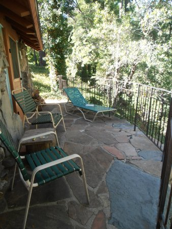 Forest Houses Resort: This is one side of the patio for our cabin. It overlooked the creek.