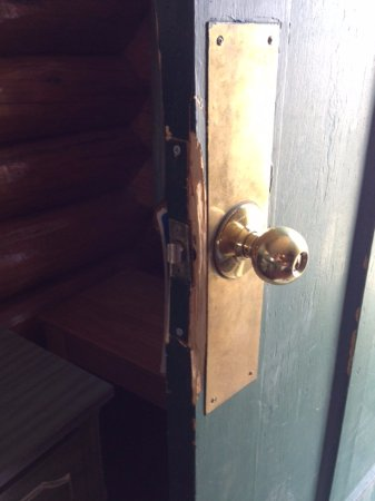 Branding Iron Inn: Splintered door to room