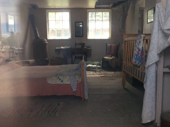 Tulelake, CA: One of the barracks set up how it may have looked for a family with a baby.entrance to the museu