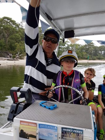 Huskisson, Australia: Everyone gets a go at being Captain on the Husky Ferry