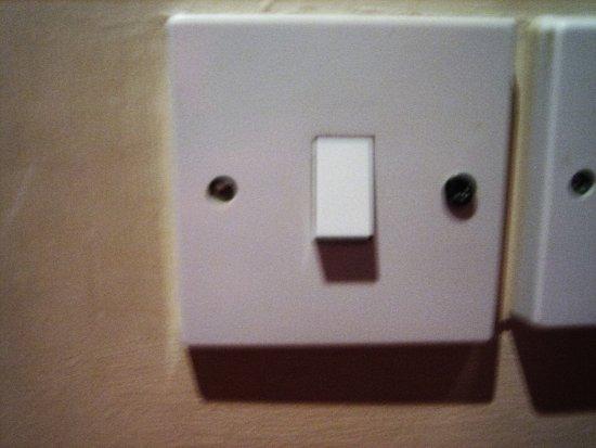Newburgh, UK: Light switch fixed with a wood screw