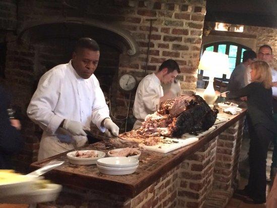 Cernay-la-Ville, France : The pig being cut up