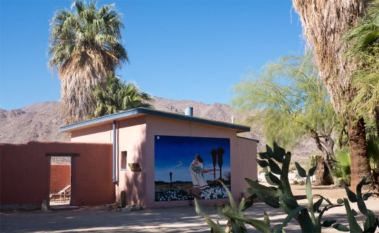 29 Palms Inn: Forget Me Not adobe bunglow with mural, looking out to the mountains of Joshua Tree National Par