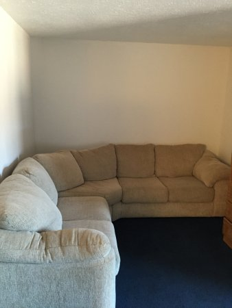 """Days Inn Manistee: This is the """"Suite"""" - a couch shoved in the corner."""