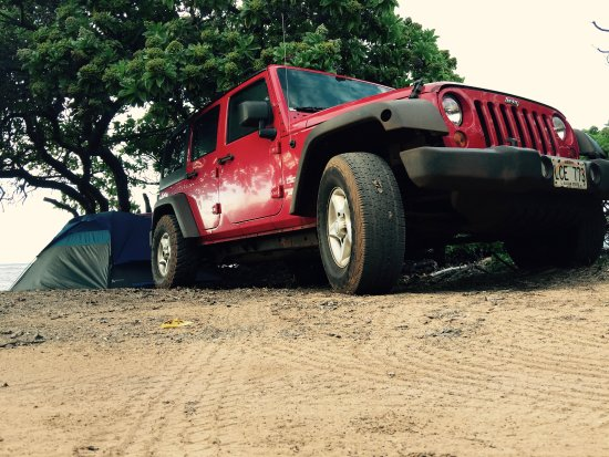 Adventure Lanai Ecocenter: The red Jeep at our campsite.