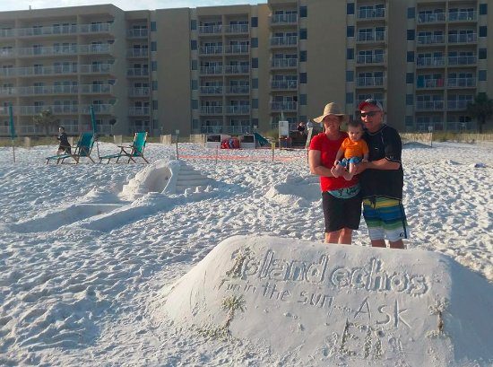 Island Echos Condominiums: View of the condo with sand art on the beach for photo ops