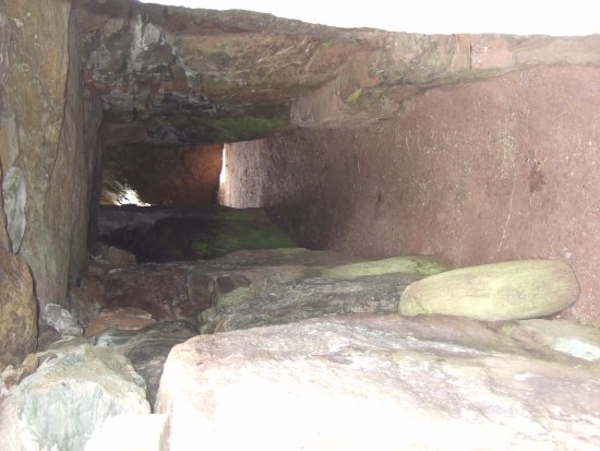Gaerwen, UK: View from entrance to tomb - note light coming in from hole at the other end