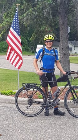 Prudenville, MI: My son ready to head out for the day from the parking lot at Reflections