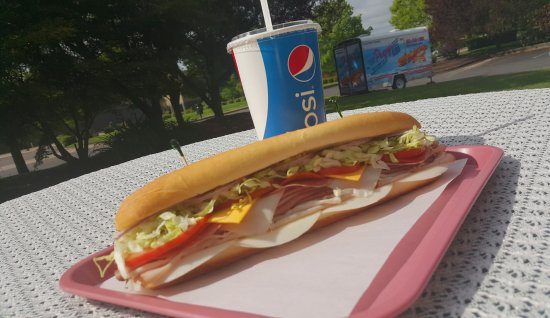 "Newberg, OR: Our largest sub, ""The Pogy."" Featuring 8 meats and 3 cheeses"